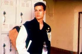 "Character from She's All That sports a letterman jacket to identify his ""jock"" status. image from kron.buzznet.com"